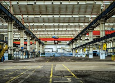 This type of workplace will need both an electric pallet lift and some scissor lift platforms.